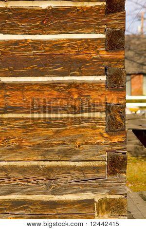 Portrait Photo Of Antique Square Log Construction