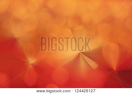 Colourful spark and blow natural bokeh in wonderful fantasy mood abstract orange red background
