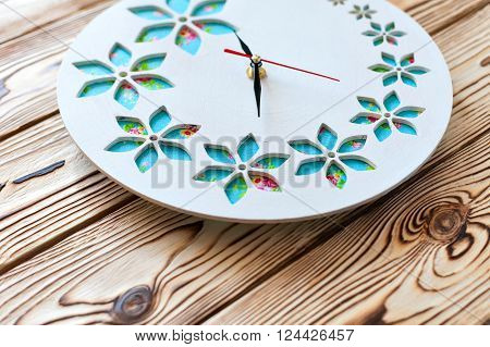 Master Class. Ready product. Watch handmade. Step by step instructions for the manufacture of clocks.  Watch his hands. White base clock with decorative holes. The clock on the wooden background.
