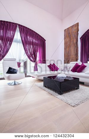 Purple living room with white leather lounge suite