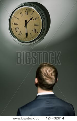 Businessman Looking At Watch With Passing Time