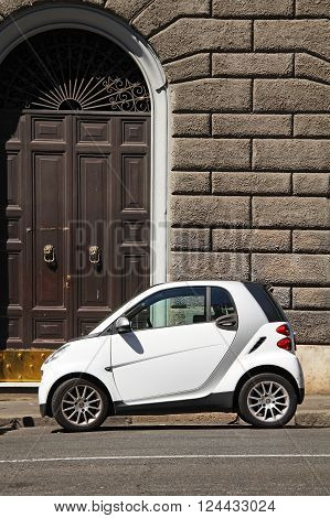ITALY ROMA - 21 August 2016: Micro white car for two person on the street of Rome.