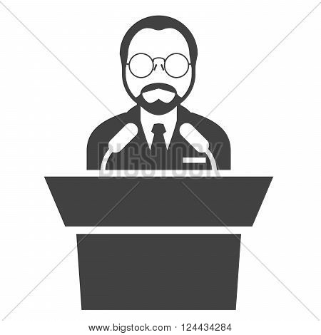 Speaker at rostrum - man in glasses at tribune presentation