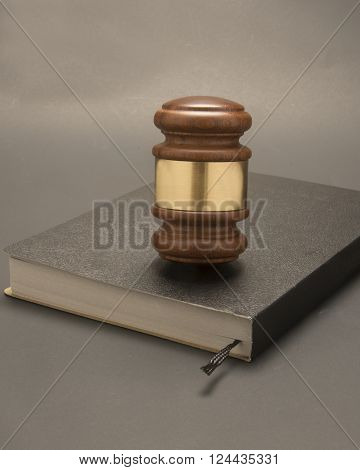 Wooden judicial gavel on a book. used for law