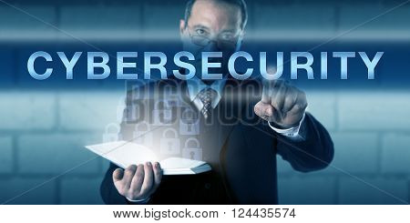 Chief Information Security Officer touching CYBERSECURITY on a visual screen. Business process metaphor and information technology concept for network security and protection of information systems.