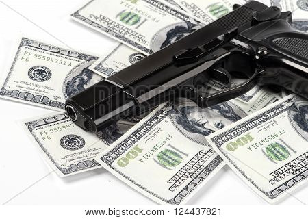 Close-up Gun pistol and money dollars background