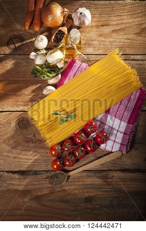 Pasta Ingredients On Wooden Background
