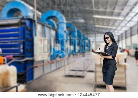 Businesswomen Or Entrepreneur Writing Down On Note Book With Blurred Working Place Background