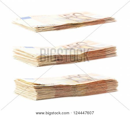 Growing stack pile of fifty euro bank notes isolated over the white background