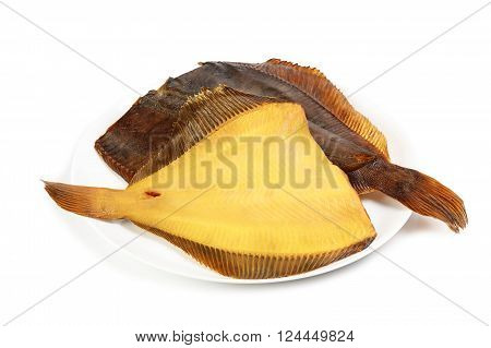Two hot smoked flatfish on plate isolated on white