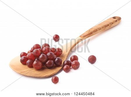 Wooden spoon ladle covered with multiple dark red grapes, composition isolated over the white background ** Note: Soft Focus at 100%, best at smaller sizes