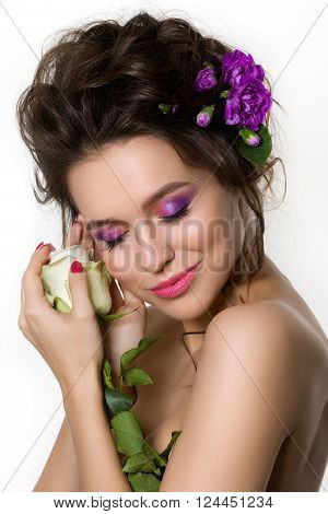 Portrait Of Young Beautiful Female Holding White Rose With Violet Cloves In Her Hair