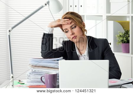 Portrait Of Tired Businesswoman Sitting At Her Office