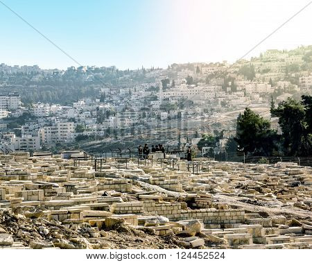 September 23 2012 .Jerusalem. Jews pray at the graves of the ancestors on the mount of olives to the old city of Jerusalem. Israel.