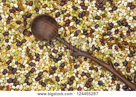 varicoloured bean and peas mix with spice and wooden spoon ** Note: Visible grain at 100%, best at smaller sizes
