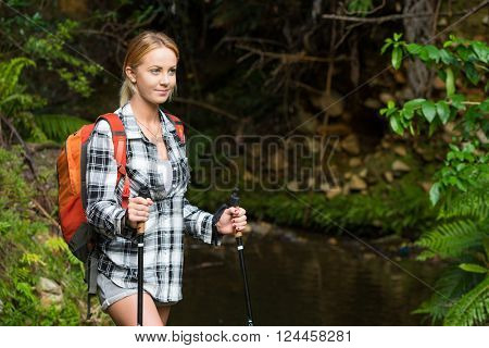 Young woman hiking in the bush