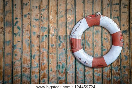 Vintage Lifebuoy Hanging On A Rustic Wooden Wall With Copy Space