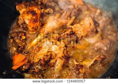 Chicken In Sauce With Carrots On A Pan Closeup