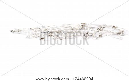 Pile of metal safety pins isolated on white background