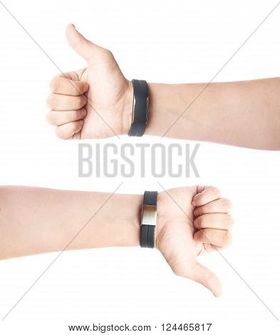 Caucasian male hand in a black sport band smart watch, composition isolated over the white background, set of two images, thumbs up and down