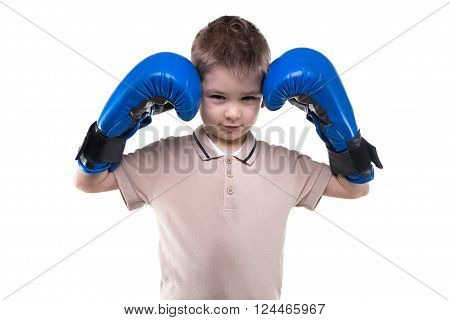 Cute blond little boy with boxing gloves on white background