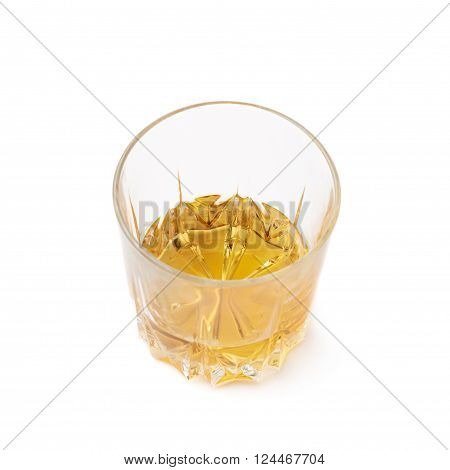 Glass tumbler filled with whiskey bourbon isolated over the white background