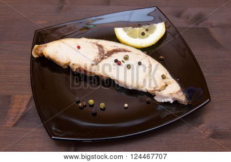 Swordfish slice on the plate on wooden table