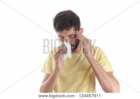 Portrait of a man sneezing with a handkerchief, isolated on white background