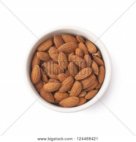 Ceramic white bowl full of almond seeds isolated over the white background