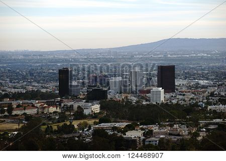 The skyline of Los Angeles with various skyscrapers in the city center surrounded by parks and infrastructure. ** Note: Visible grain at 100%, best at smaller sizes