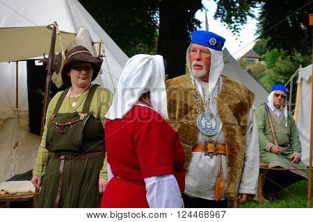 Zug, Switzerland, September 26, 2015: Some people in medieval clothes at the medieval market.