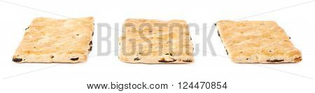 Three single raisin cracker cookies isolated over the white background