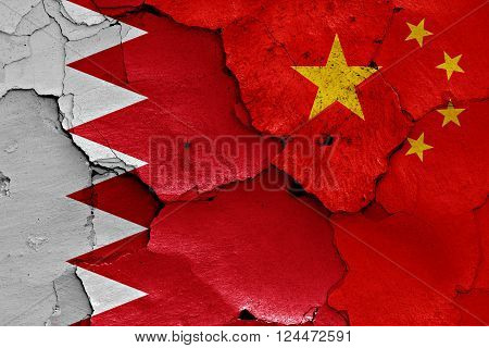 3d flags of Bahrain and China painted on cracked wall