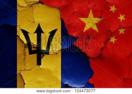 flags of Barbados and China painted on cracked wall