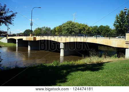 Vehicles cross a bridge over the DuPage River in downtown Plainfield, Illinois.