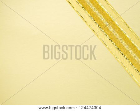 Golden ribbon on yellow space in elegance rewarding background concept
