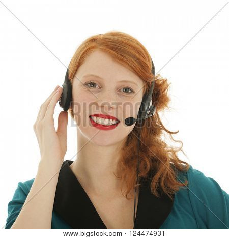 Young red haired woman with head set for call center