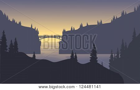 silhouette mountain in sea and bridge at the morning