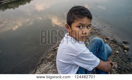 scared and alone, young Asian child, selective focus