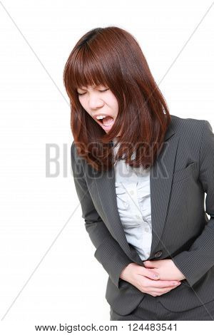 portrait of young Japanese businesswoman suffers from stomachache