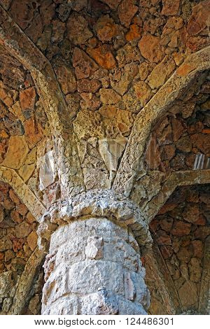 BARCELONA, SPAIN - JULY 31, 2015: Part of masonry stone column designed by Antoni Gaudi in Park Guell