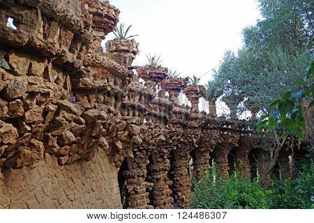 BARCELONA, SPAIN - JULY 31, 2015: Arcade of masonry stone columns designed by Antoni Gaudi in Park Guell
