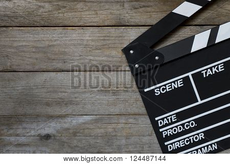 movie clapper on wood table, top view