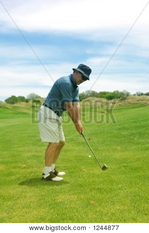 Middle Aged Man Playing Golf.