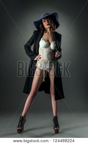 Sensuality and style. Glamorous woman posing at camera