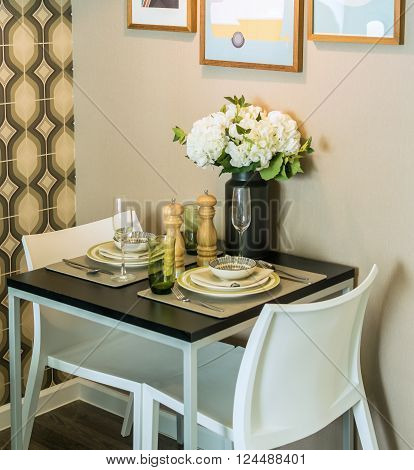 table set with chairs in dinning room