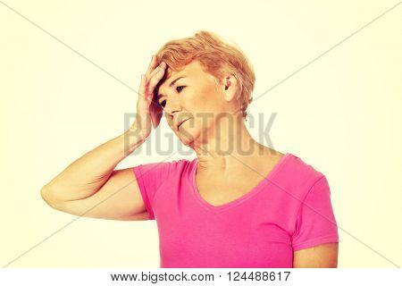 Senior woman with huge headache
