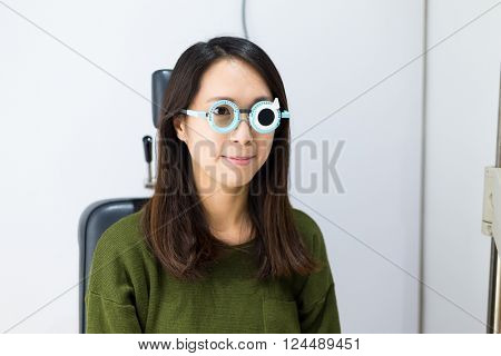 Woman doing eye test in optical clinic