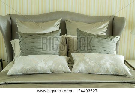 Concept for luxury bedroom with pillows at home