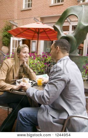 Young Couple Enjoying Brunch Together